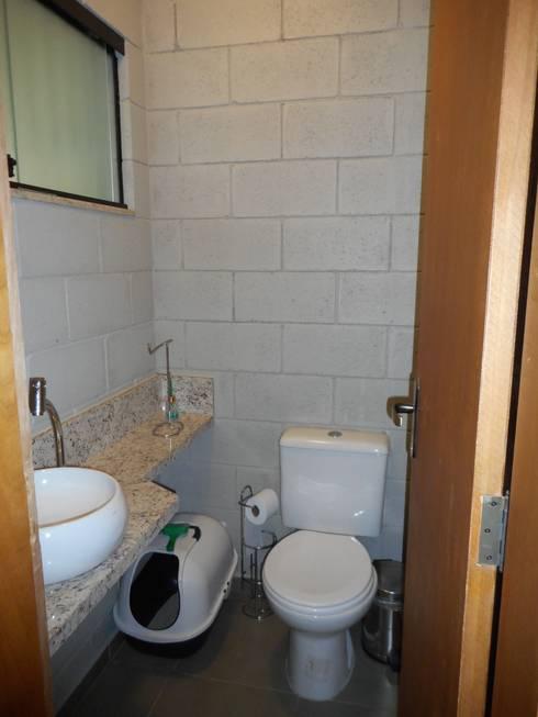 Lavabo: Banheiros rústicos por Metamorfose Arquitetura e Urbanismo