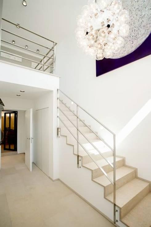 Ingresso & Corridoio in stile  di ABAD Y COTONER, S.L.