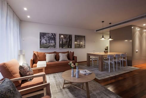 TROIA RESORT - ATLÂNTIC VILAS: Sala de estar  por Tralhão Design Center