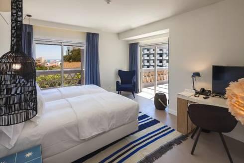 Pavimento de um dos Quartos em Microcimento: Hotéis  por 4Udecor Microcimento