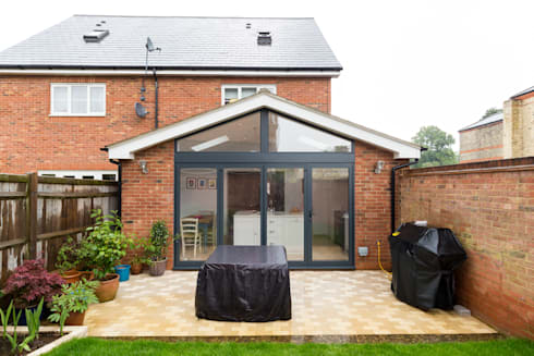 White kitchen in a rear extension: classic Kitchen by Black Oak Builders Ltd.