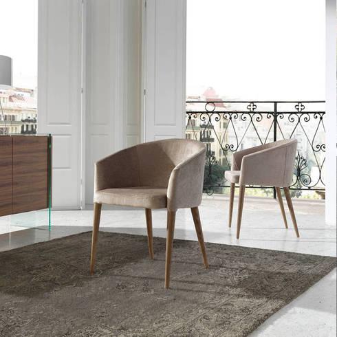 Cadeirões de jantar Dining armchairs www.intense-mobiliario.com  RETRO http://intense-mobiliario.com/pt/cadeiroes-de-jantar/8842-cadeirao-retro.html: Sala de jantar  por Intense mobiliário e interiores;