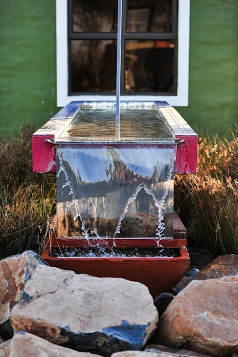 Water Feature:  Houses by OLIVEHILL Architects
