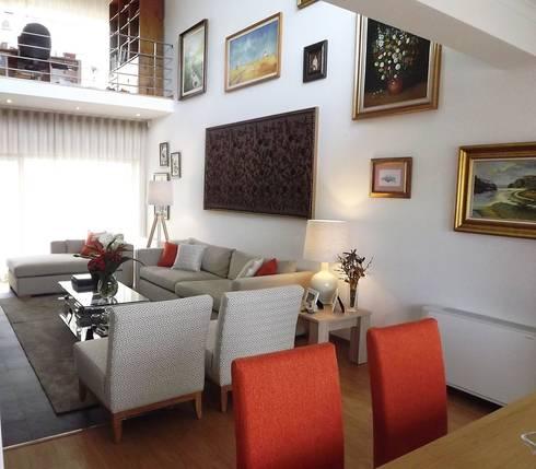 Sala - Vista da zona de refeição: Sala de jantar  por Traço Magenta - Design de Interiores