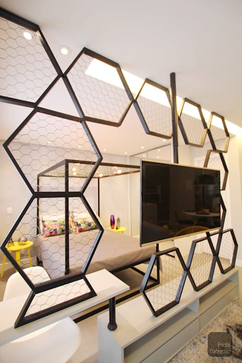 Loft: Salas de estar  por Pricila Dalzochio Arquitetura e Interiores