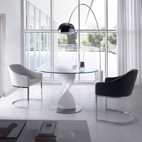 Mesa redonda com design moderno Round table with modern design : Sala de jantar  por Intense mobiliário e interiores;