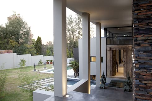 Entrance colonnade:  Patios by Spiro Couyadis Architects
