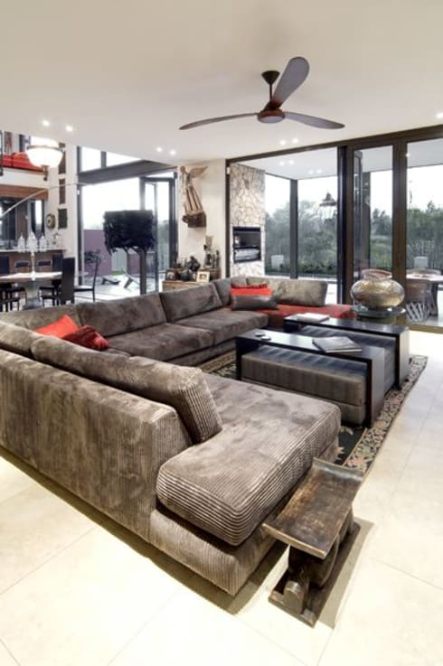AT WATER'S EDGE:  Living room by Spiro Couyadis Architects