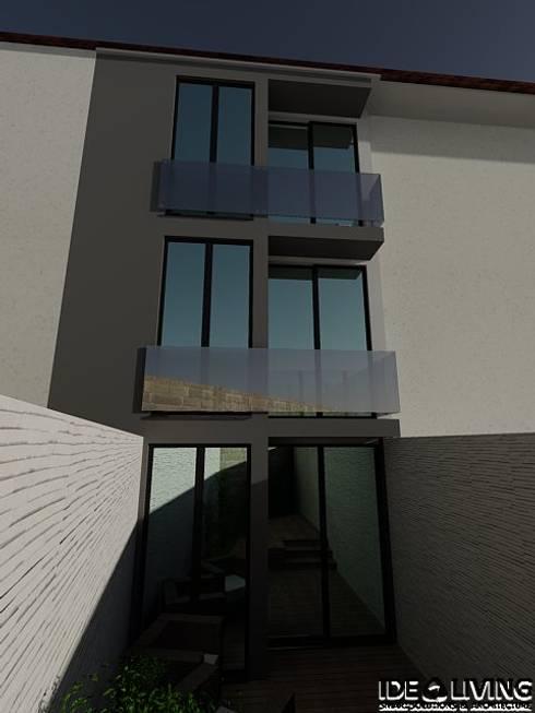 Fachada Traseira: Casas minimalistas por Idealiving