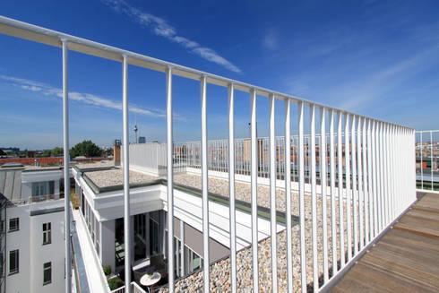 rooftop view towards Alexanderplatz: modern Houses by brandt+simon architekten