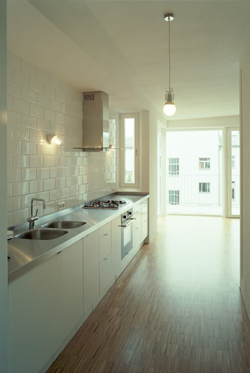 lichten:  Kitchen by brandt+simon architekten