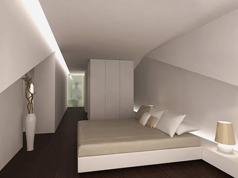 Reformulaçao de um apartamento no centro historico: Quartos minimalistas por 2L'atelier arquitectos