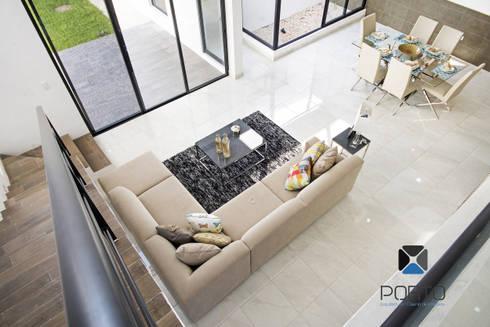 PROYECTO NN23: Salas de estilo moderno por PORTO Arquitectura + Diseño de Interiores