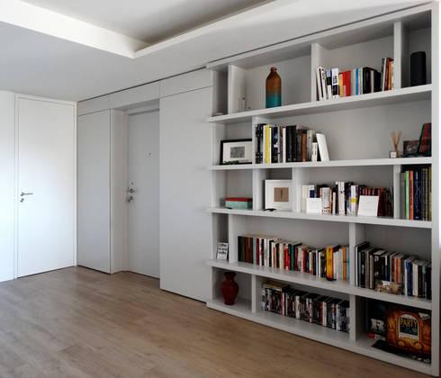 Casa Amaro: Salas de estar modernas por há.atelier