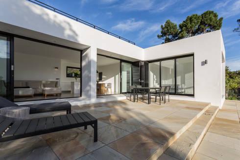 House Hout Bay - Babett Frehrking Architect:  Patios by Babett Frehrking Architect