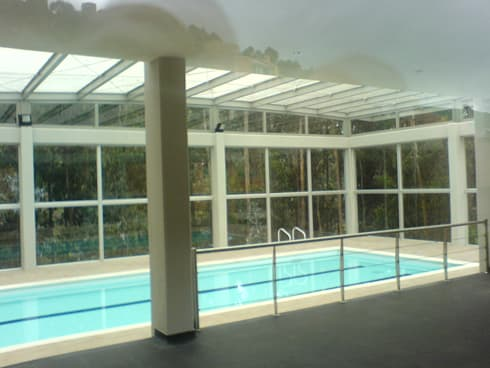 Club House: Piscinas de estilo moderno por Vertice Oficina de Arquitectura