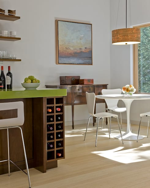 Kitchen wine storage and dining area:  Dining room by ZeroEnergy Design