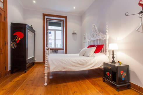 Apartamento Alma Lusa, uma casa portuguesa, com certeza!: Quartos rústicos por alma portuguesa