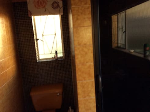View of shower before:   by Urban Dwellers Design Studio