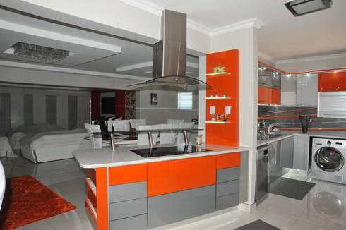 Orange and Silver Niemann Kitchen with Cesar Stone Work Tops.: modern Kitchen by Expert Kitchens and Interiors