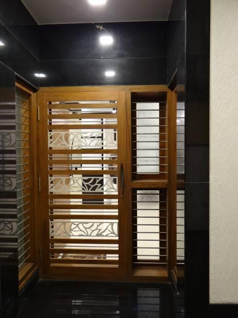 Safety Door:  Corridor & hallway by Hasta architects
