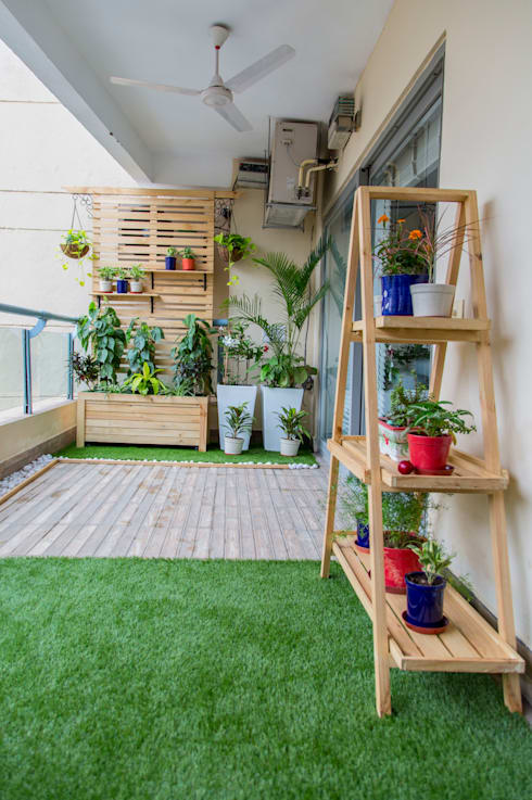 After - combination of grass and the original wooden tiles.:   by Studio Earthbox