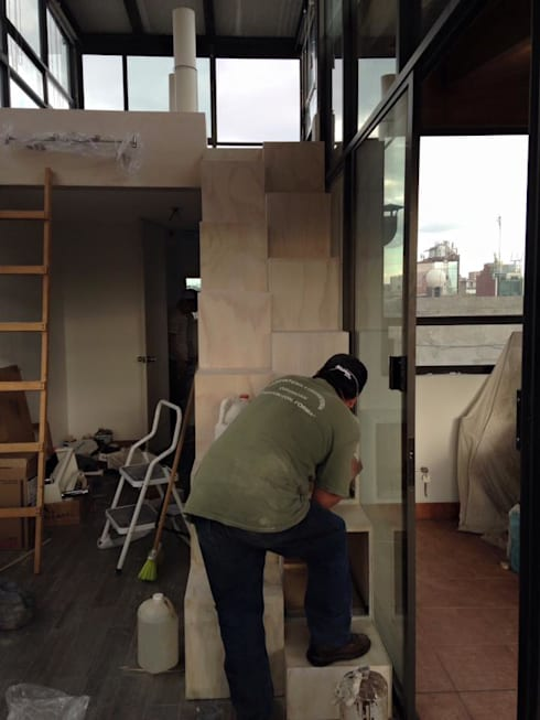 Escalera librero de l g arquitectos homify for Librero escalera