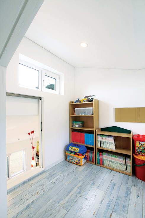Nursery/kid's room by 춘건축