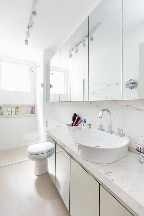 SRR | Banho: Banheiros  por Kali Arquitetura