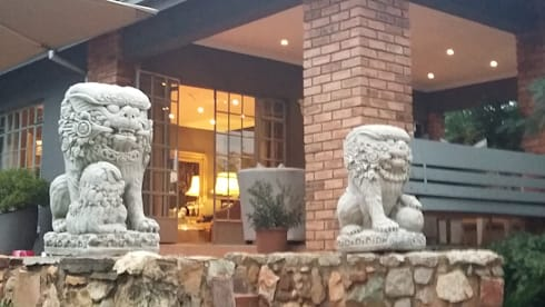 Grey House: eclectic Houses by CKW Lifestyle
