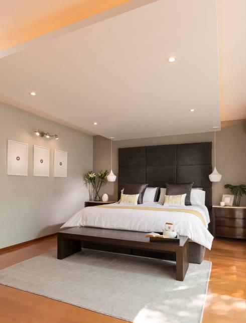 Casa RR: Recámaras de estilo moderno por MM estudio interior
