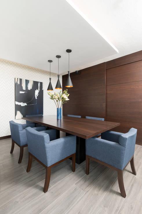 Casa RR: Comedores de estilo moderno por MM estudio interior