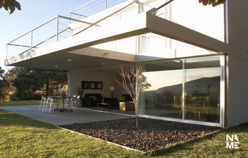 JARDIN: Casas de estilo moderno por NAME Arquitectos