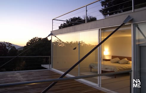 RECAMARA PRINCIPAL: Recámaras de estilo moderno por NAME Arquitectos