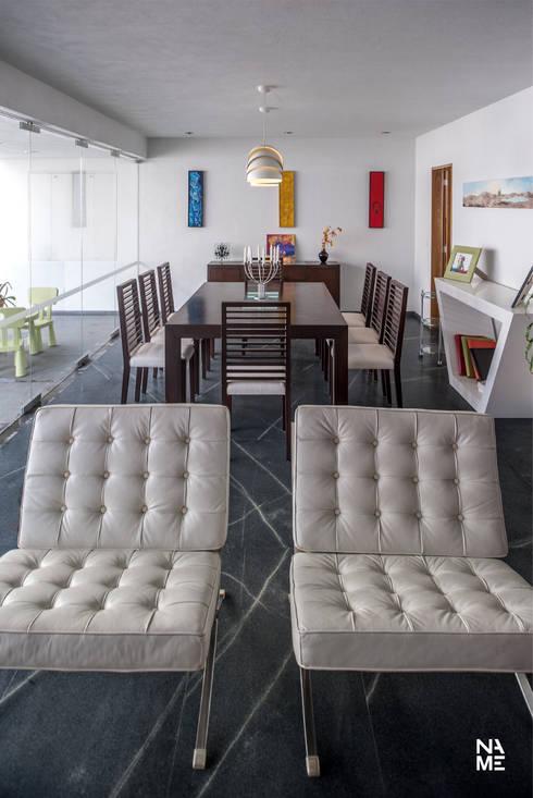 SALA Y COMEDOR: Comedores de estilo moderno por NAME Arquitectos