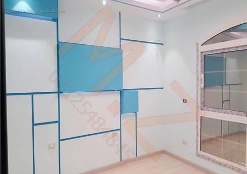 تشطيب فيلا K مدينتي -القاهرة :  غرفة الاطفال تنفيذ شركة زمزم للتصميم و التفيذ المعماري