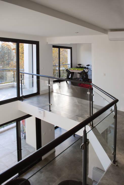 Maison Chatenay-Malabry: Salon de style  par Daniel architectes