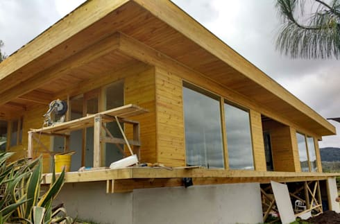 La limpieza de la construcción en madera:  de estilo  por Taller de Ensamble SAS