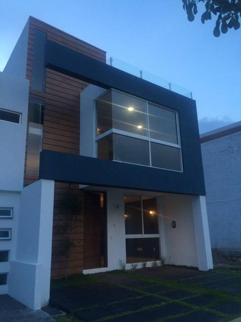 modern Houses by Arquimia Arquitectos