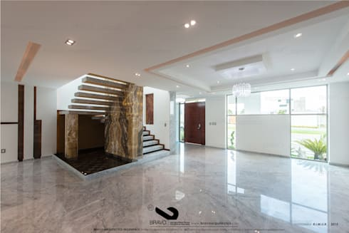 ESCALERA: Salas de estilo minimalista por BRAVO ARQUITECTOS INGENIEROS