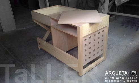 Escritorio/librero/guarda/multimedia a+f9 el tibu nanos. Ahora en realidad aumentada.: Estudio de estilo  por argueta+f9 arquitectura