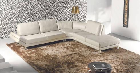 Sofás de canto Corner sofas www.intense-mobiliario.com  MILLOT : Sala de estar  por Intense mobiliário e interiores;
