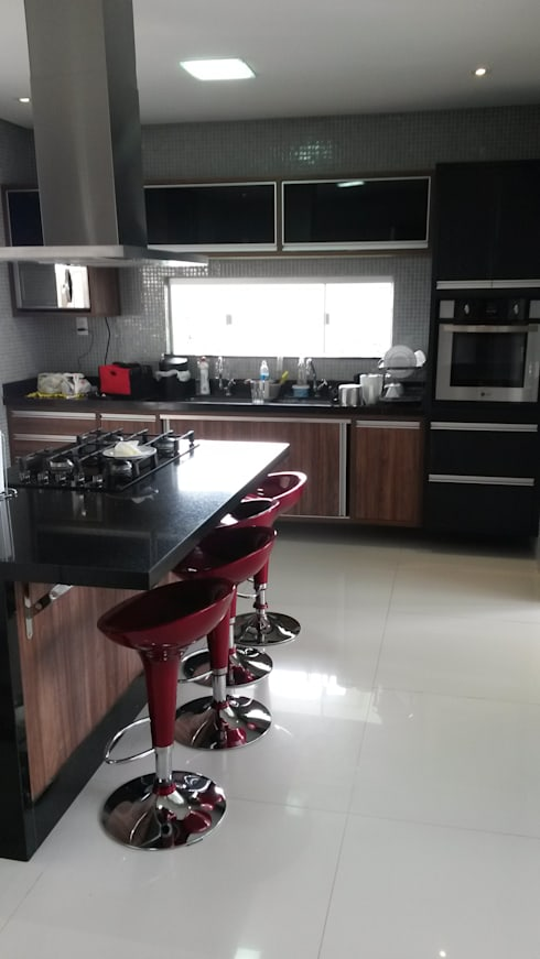 Cozinha: Cozinhas modernas por Rmlo Arquitetura . Design . Iluminação