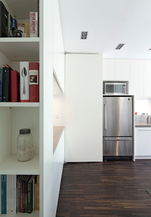 Custom Hidden Door to basement: modern Kitchen by STUDIO Z