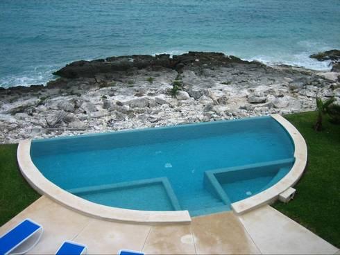 VILLA GAUGUIN: Casas de estilo moderno por SG Huerta Arquitecto Cancun