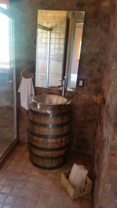 Baños de estilo  por Cervantesbueno arquitectos