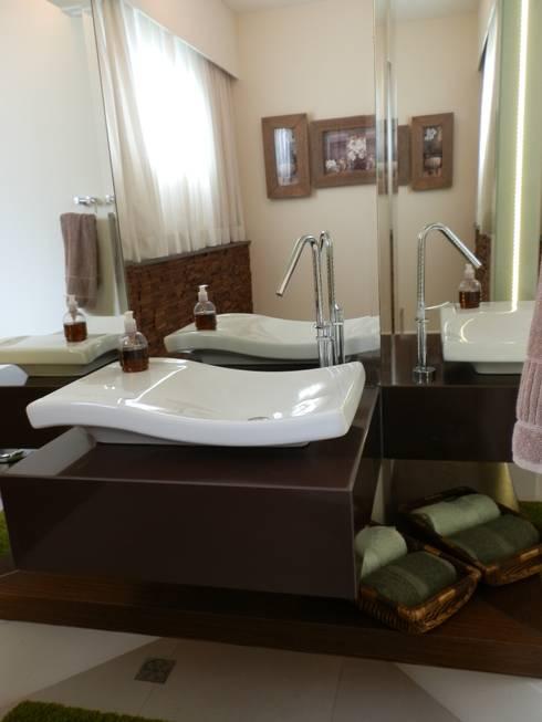 Lavabo rústico e elegante: Banheiros  por MBDesign Arquitetura & Interiores