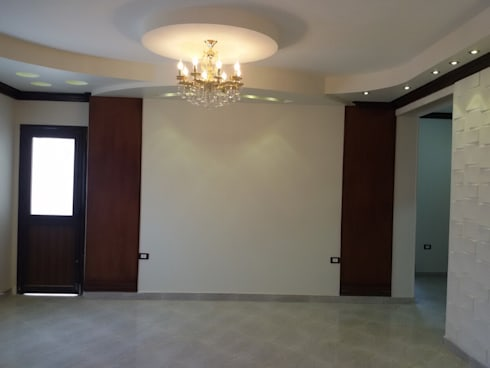 Mr. Hamdy Appartment:  غرفة المعيشة تنفيذ Etihad Constructio & Decor