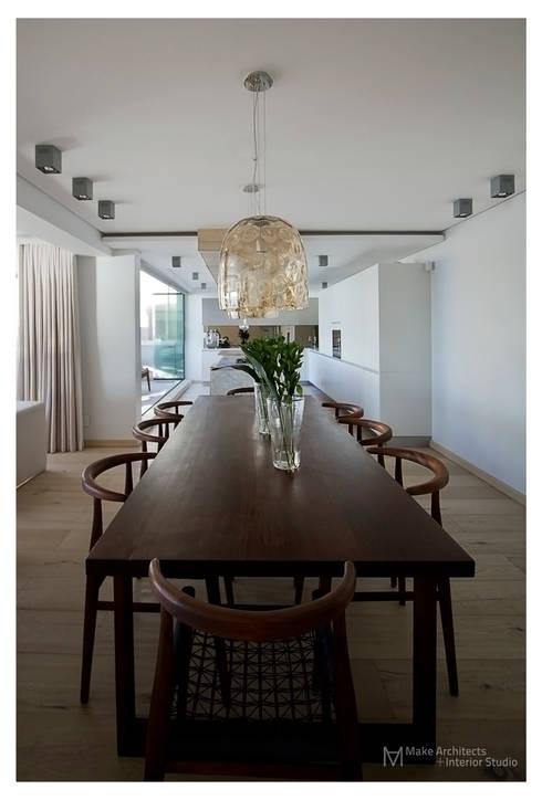 Costa Brava: modern Dining room by Make Architects + Interior Studio