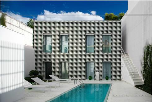 Projecto com Arq. Juan Trindade: Casas modernas por Sant'Anna